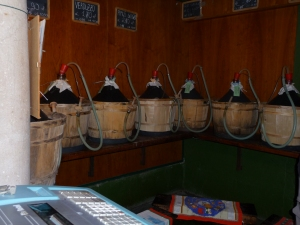 Jugs of wine ready to fill your container at Vineria Nave de Oro